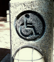 accessibility symbol carved into a stone pillar