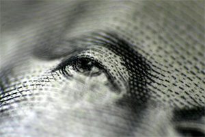close-up photo of George Washington's eye from a one dollar bill